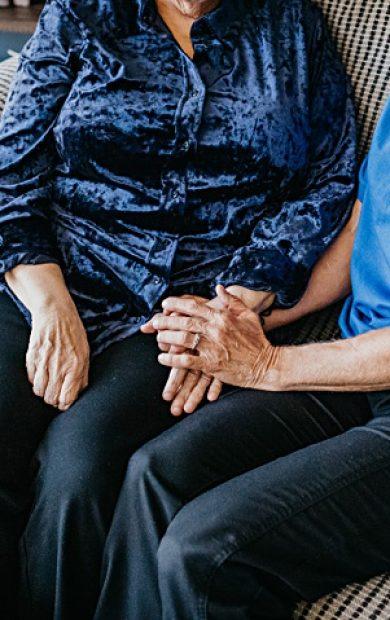 caregiver-client-holding-hands