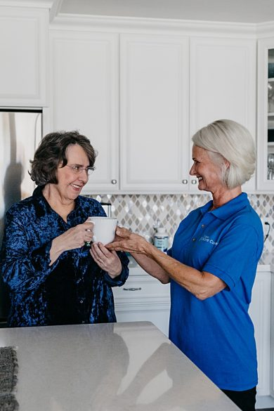 caregiver-serving-client-coffee